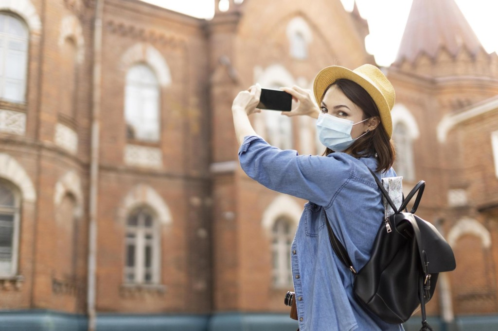 stylish-traveller-with-hat-taking-pictures-holiday